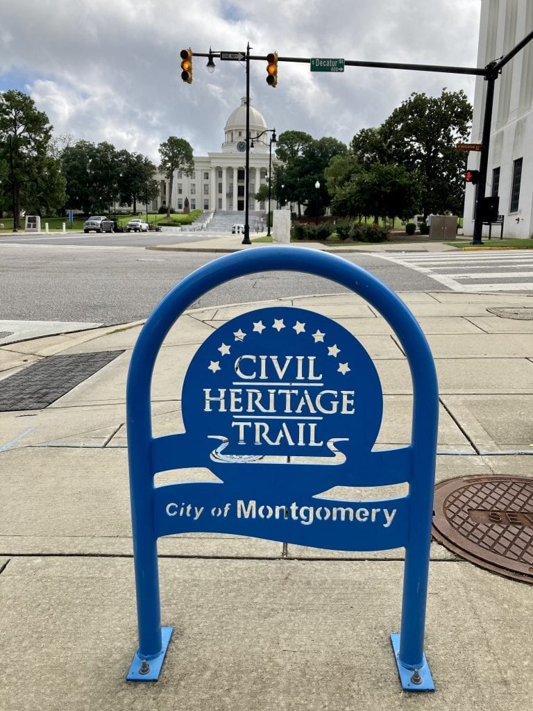 Civil rights heritage trail sign with Alabama State Capitol in the background