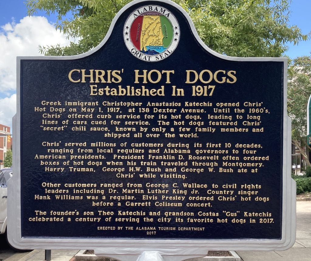 Sign telling the story of Chris' hot dogs and the Greek immigrants who arrived in the US and set it up in 1917