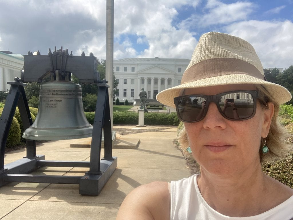Photo of author at the State Capitol bell in Montgomery, Alabama