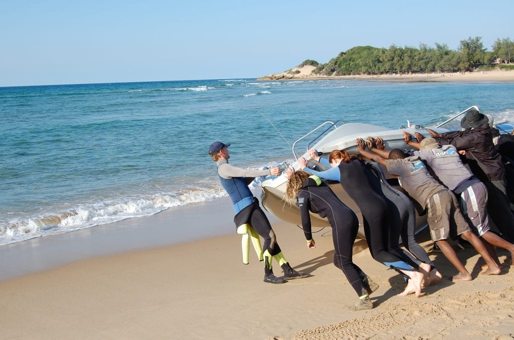Getting the dive boat into the water, Tofo, Mozambique