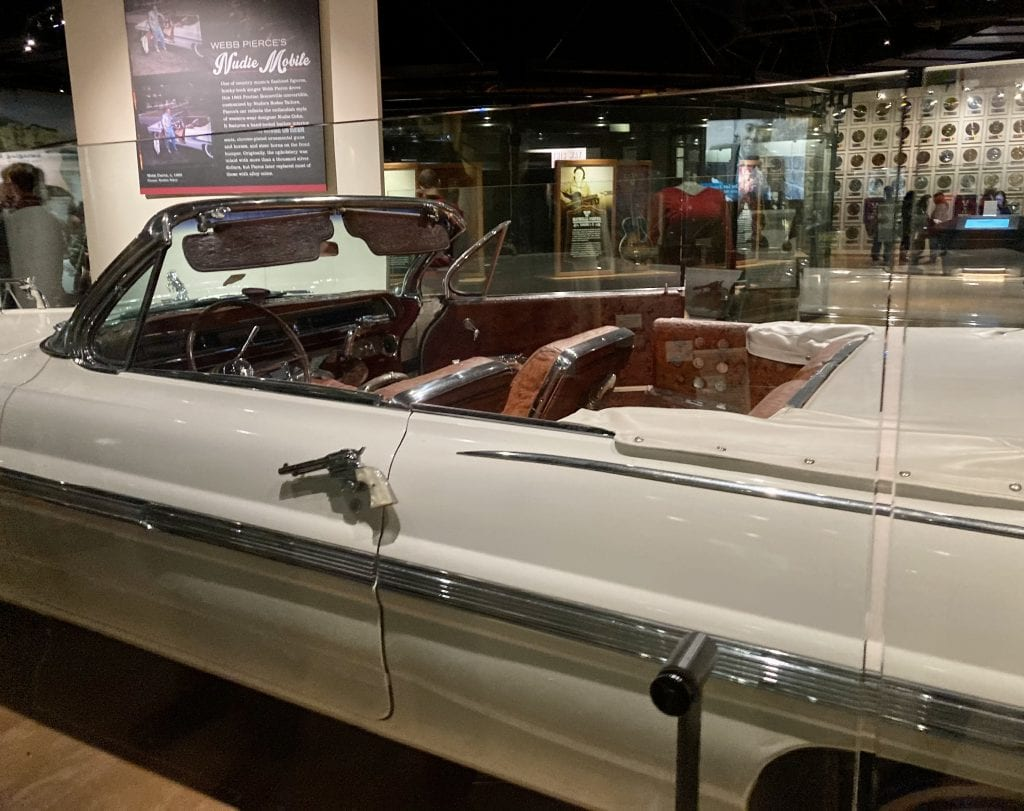 Car at the Country Music Hall of Fame museum, showing detail of guns used as door handles