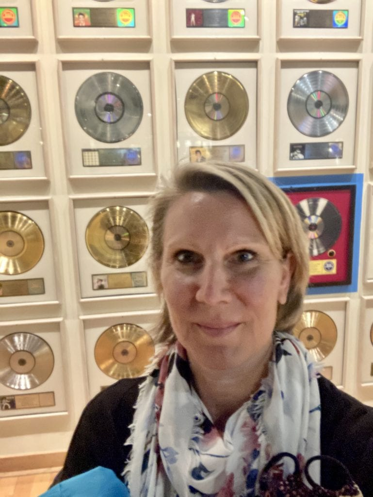 Wall of gold and platinum albums selfie