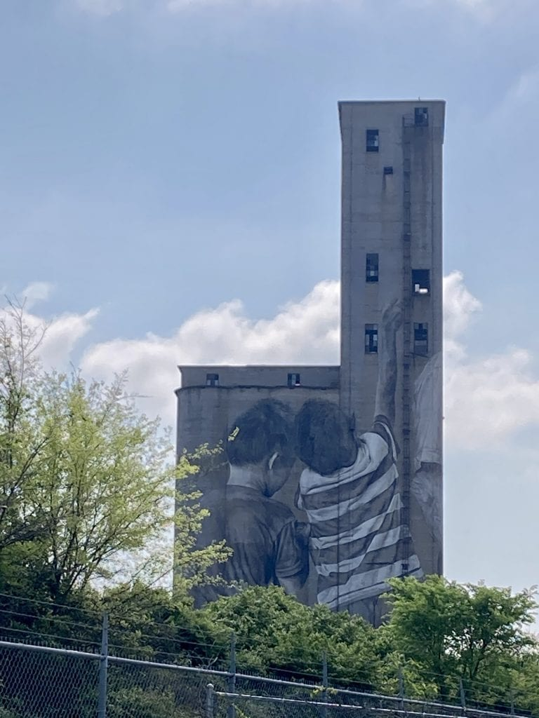 Mural of an boys playing on an industrial site, the Nations neighbourhood, Nashville