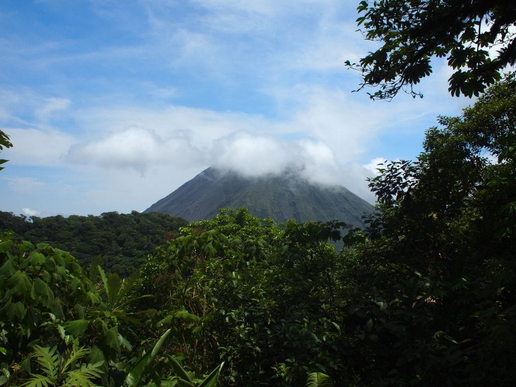 Arenal volcano's cone hidden by clouds in Fortuna, Costa Rica